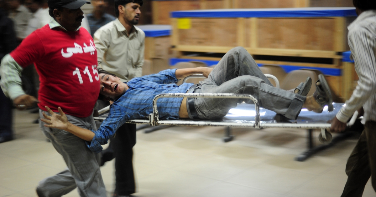 Pakistani volunteers carry an injured blast victim into a hospital in Karachi on November 21, 2012. Militants hit Pakistani security forces on the eve of a major international summit, killing 10 people in regional flashpoints on Wednesday as delegates arrived in the capital Islamabad.</p>