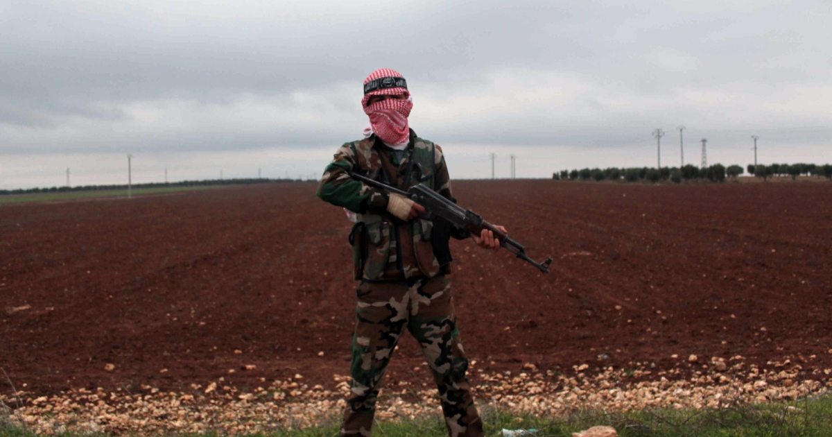 A member of the Syrian opposition's Al-Buraq Brigade, which is said to be made up mainly of fighters who defected from the Syrian army, stands guard on December 10, 2012 on a main road in the northern Syrian town of Ain Dakna, close to the Managh military airport, only six kilometres from the Turkish border.</p>