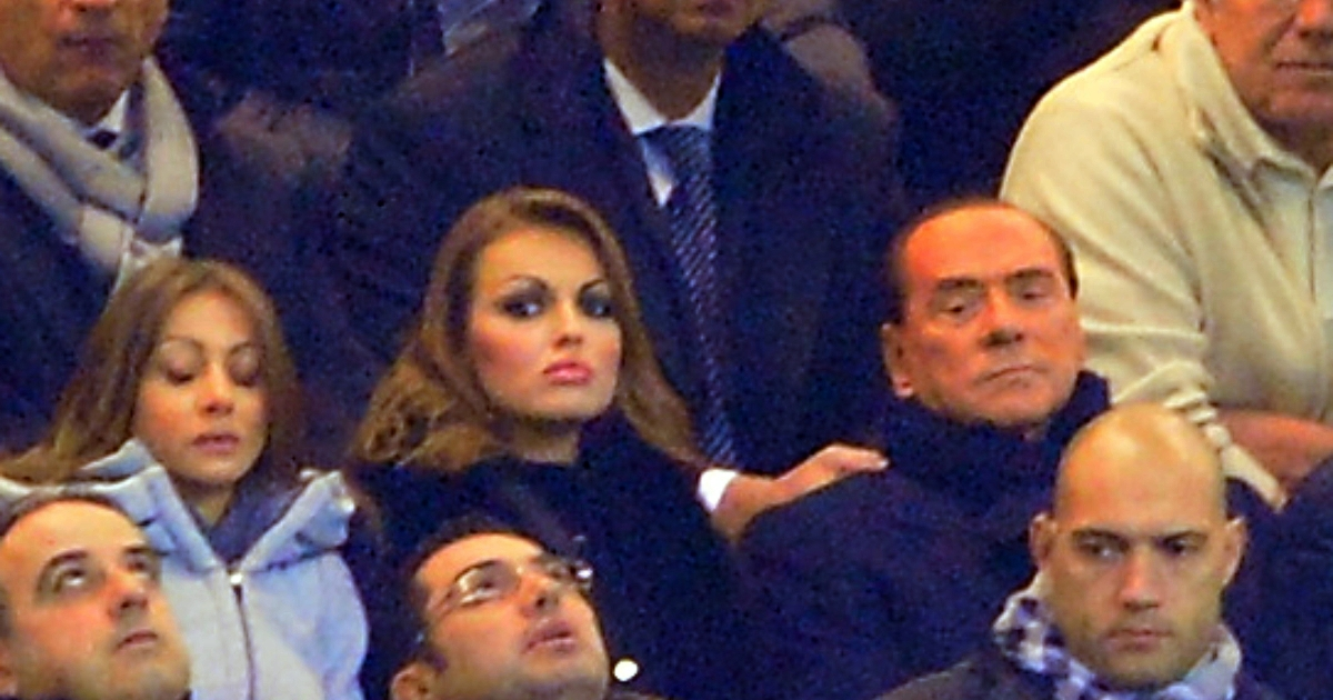 In this picture taken on December 4, 2012 AC Milan's president Silvio Berlusconi (R) sits with his fiancee Francesca Pascale (L) during the Champions League match AC Milan vs FC Zenith at the at San Siro Stadium in Milan.</p>