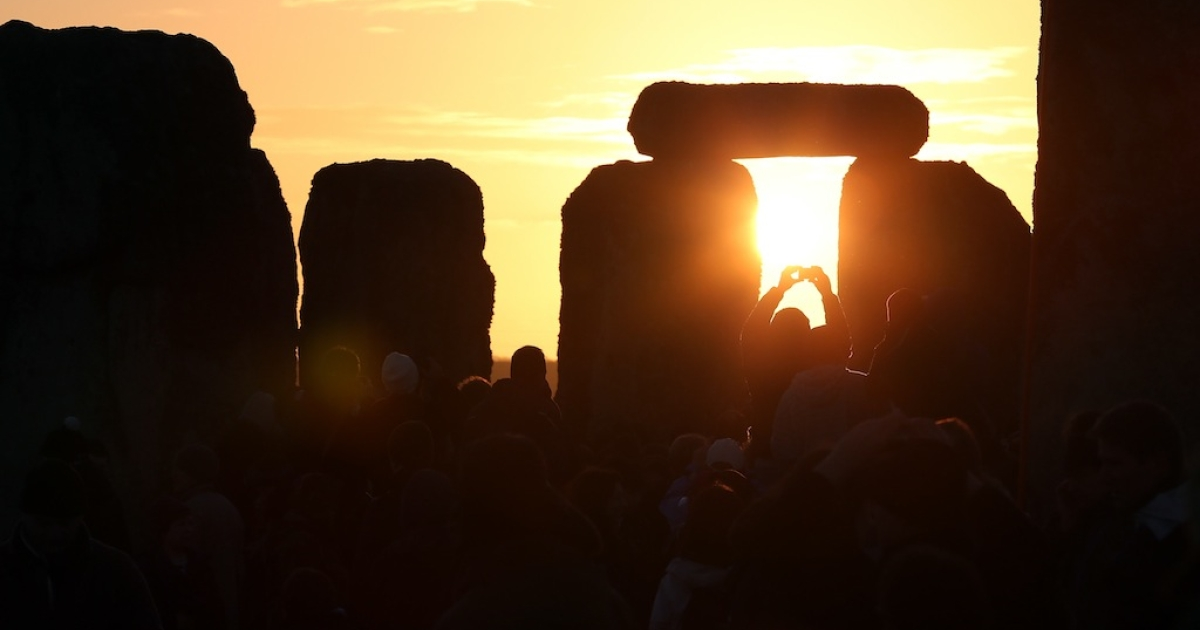 A woman dances as druids, pagans and revellers take part in a winter solstice ceremony at Stonehenge on December 21, 2012 in Wiltshire, England.</p>