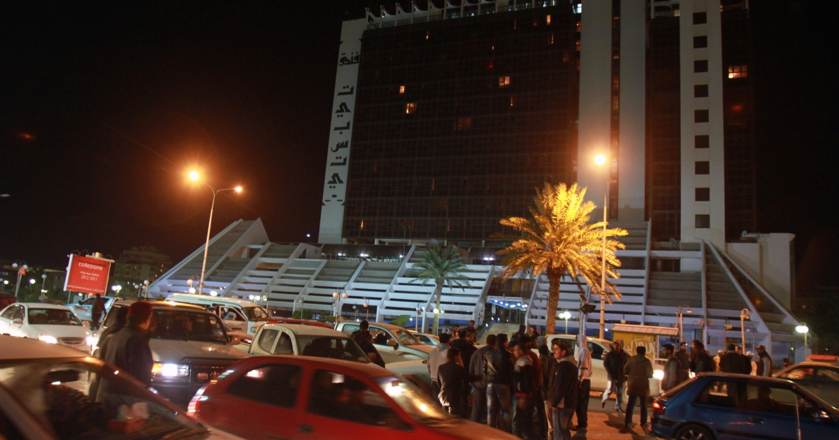 Libyan policemen in civilian clothing outside the Tibesti hotel in Benghazi, on January 3, 2013.</p>