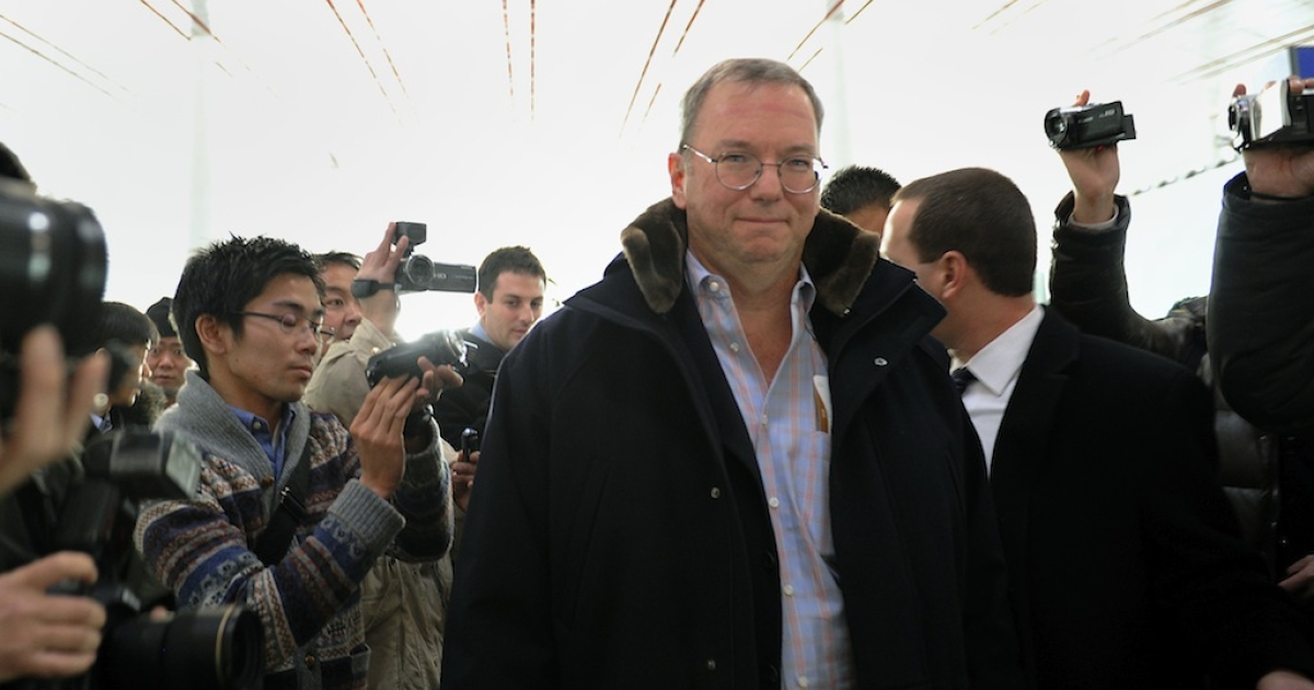 Google Executive Chairman Eric Schimidt (C) makes his way after checking in at Beijing International airport in Beijing on January 7, 2013, before his trip to North Korea.</p>