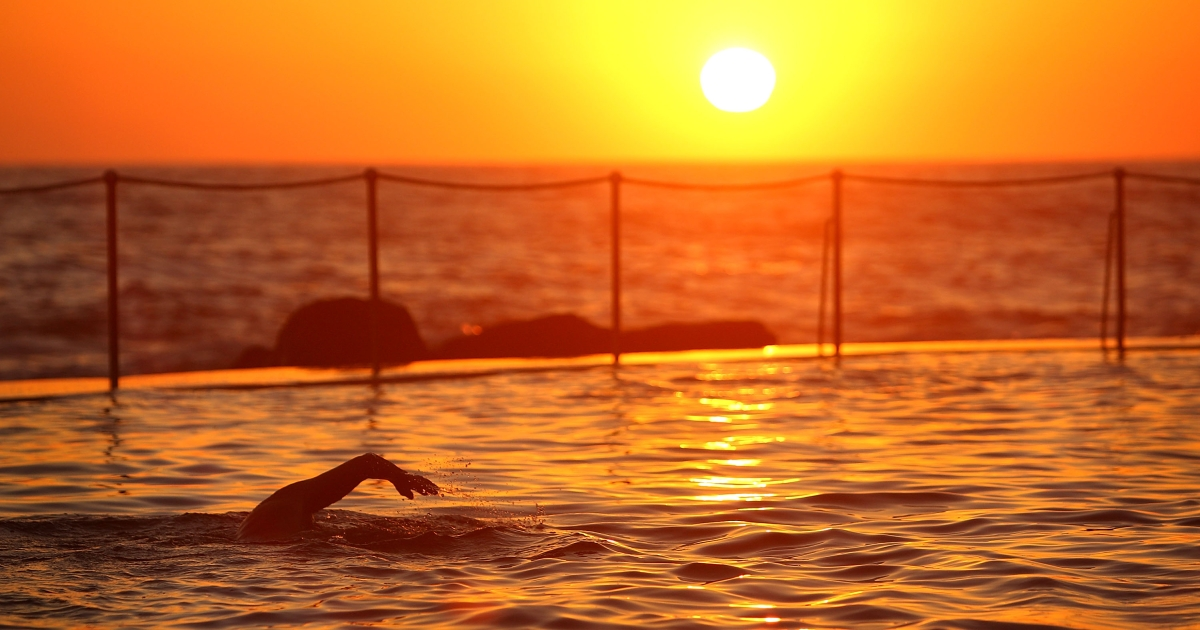 Sunrise swimmers take to Bronte Pool in Bronte Beach to beat the heat as temperatures are expected to reach record highs today on January 8, 2013 in Sydney, Australia.</p>