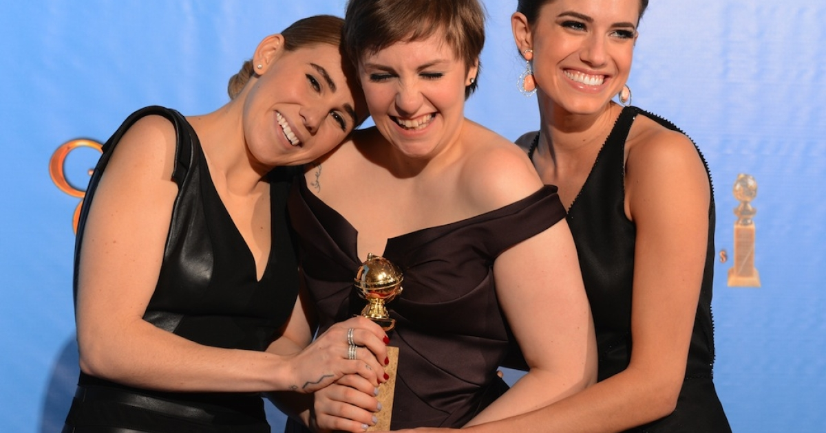 Lena Dunham (C) poses in the press room with her award for