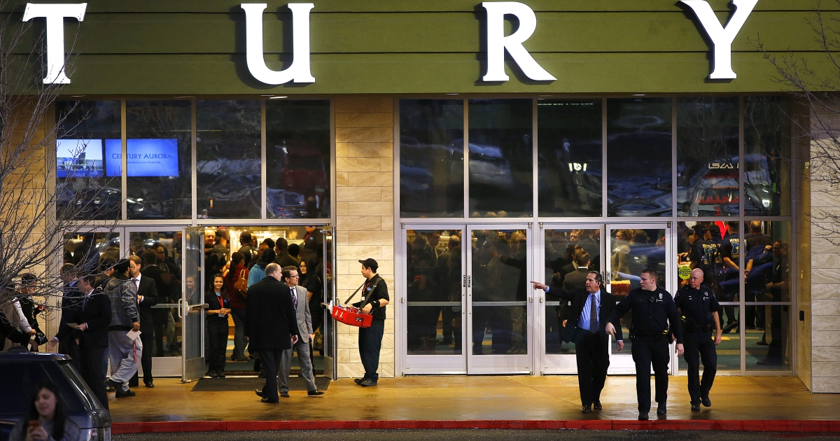 Invited guests make their way into a reopening ceremony and evening of remembrance at the Cinemark Century 16 Theaters in Aurora, Colorado on January 17, 2013. The theater was the site of of a mass shooting in July 2012 that killed 12 people and wounded dozens of others.</p>