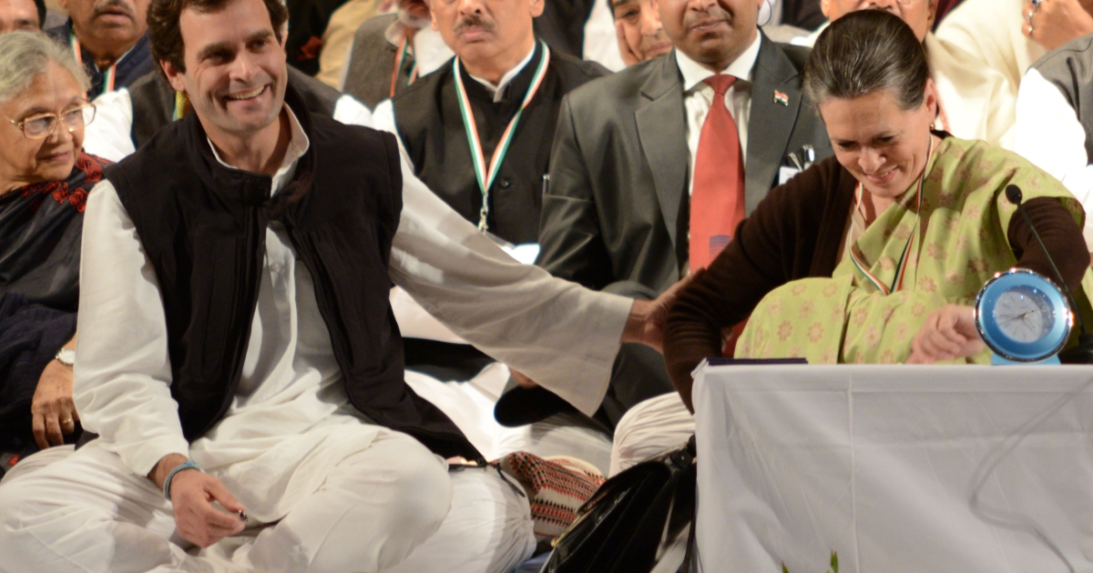 Congress party Vice-President Rahul Gandhi (L) gestures as he shares a light moment with his mother, Congress Party President Sonia Gandhi (R), during the Congress party leadership conclave in Jaipur on January 20, 2013.</p>
