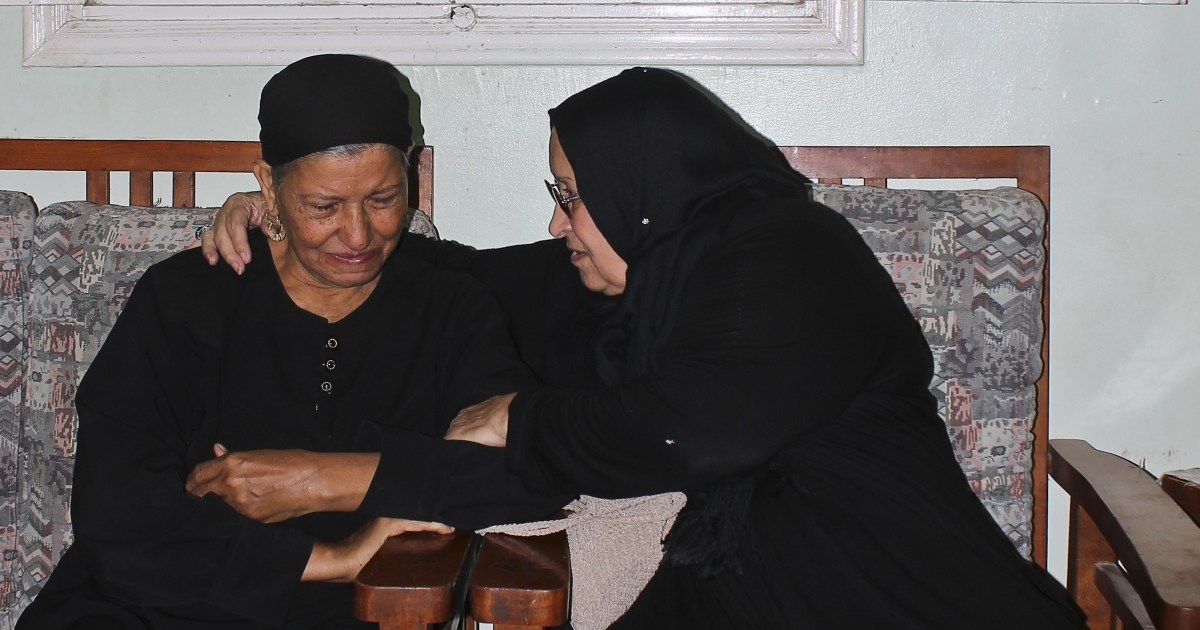 Nadia Beshara (L), mother of Mina Daniel, and Leila Said (R), mother of Khalid Said, embrace at the Daniel family's home on the outskirts of Cairo in October 2011.</p>