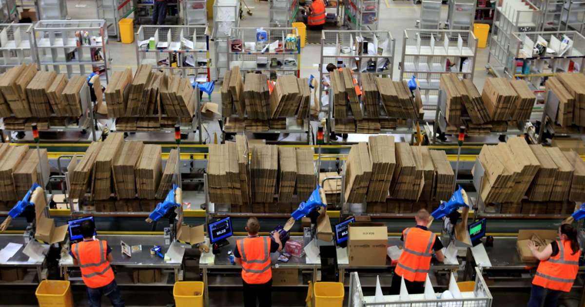 Staff at the Amazon Swansea fulfilment centre process orders as they prepare their busiest time of the year on November 24, 2011 in Swansea, Wales.</p>