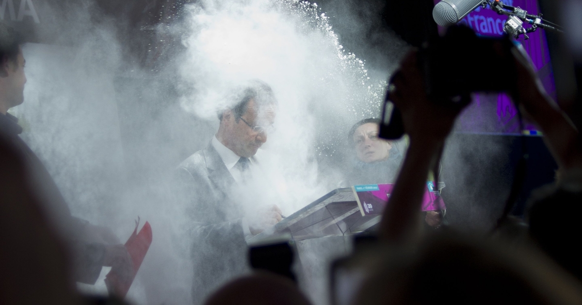 Hollande's bodyguards sprang forward to protect the Socialist presidential candidate and rushed his assailant to her feet after she attacked him with a bag of flour.</p>