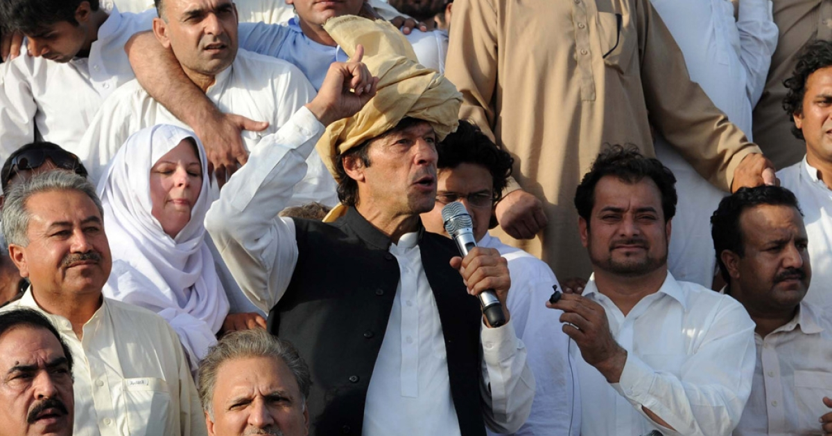 Pakistani politician Imran Khan addresses a peace rally in Tank on October 7, 2012. Khan and his followers were stopped from entering Pakistan's tribal region after they bypassed road blocks to press towards the region to protest against US drone strikes.</p>