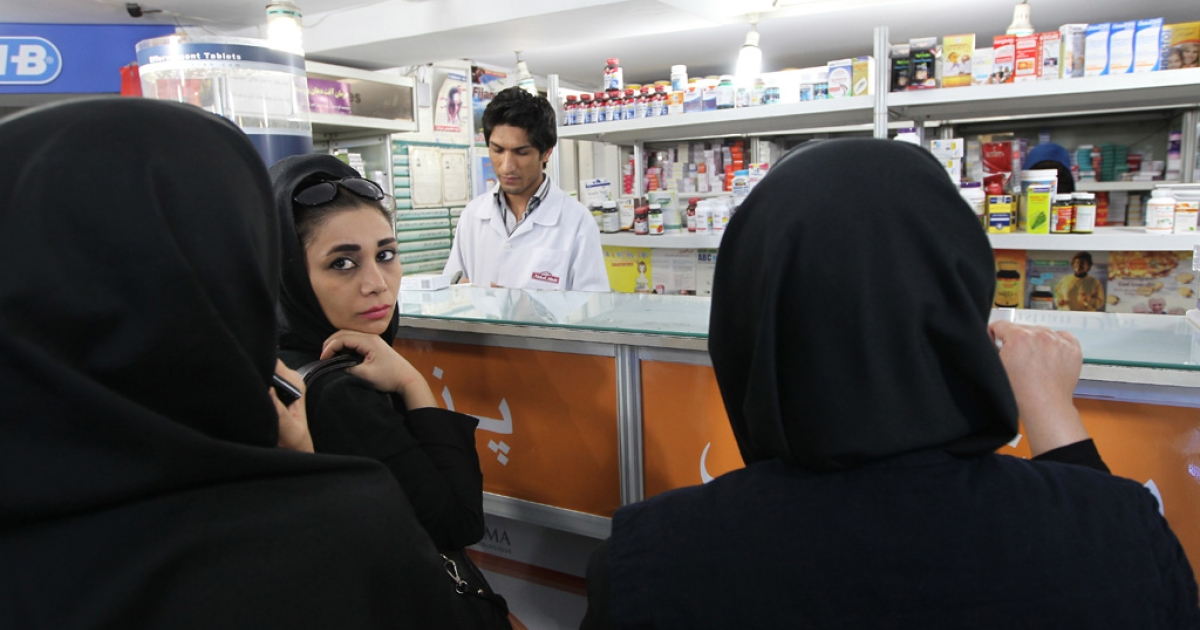 Iranian women buy medicine from a pharmacy in Tehran on October 21, 2012.</p>