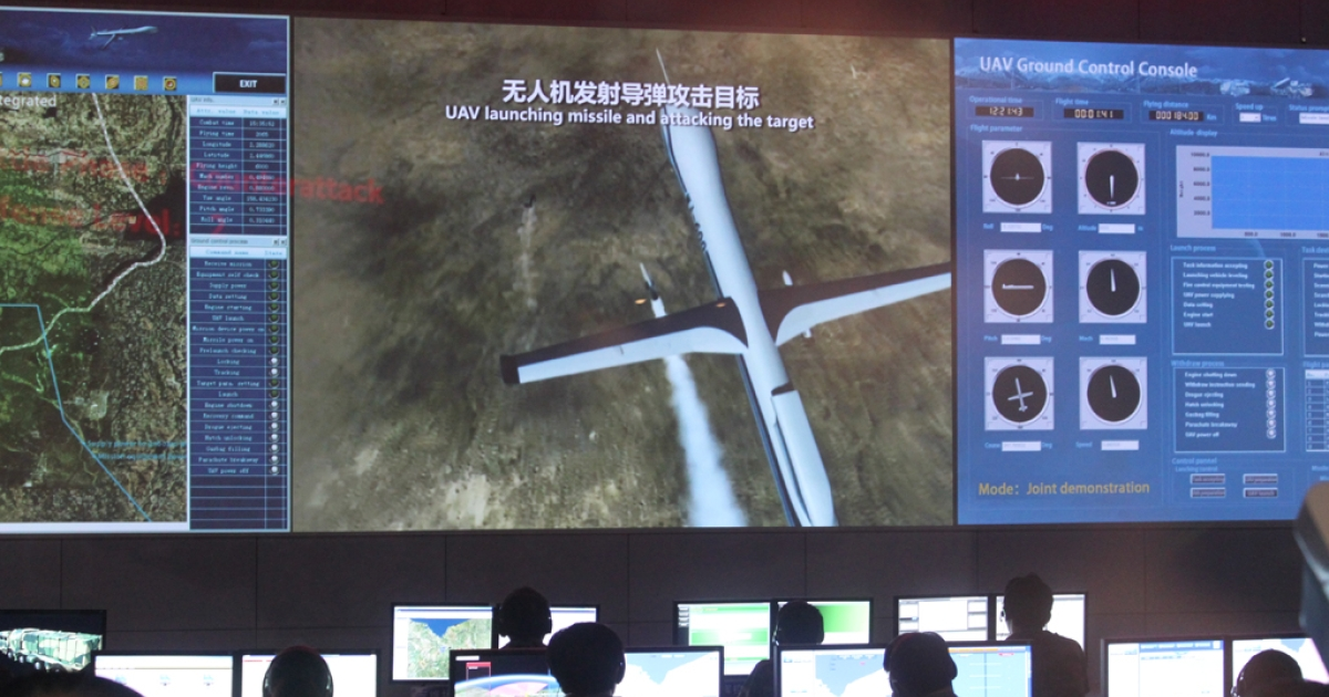 A simulation attack sequence of the CH-4 (Rainbow-4) UAV at the China Aerospace Science and Technology Corporation pavilion at the Zhuhai Air Show, Nov. 13, 2012.</p>