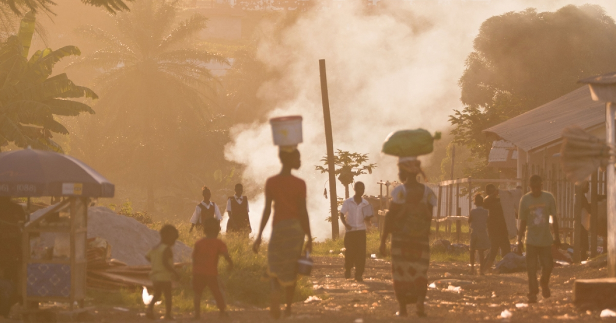 A girl and woman walk down a path in rural Liberia.</p>