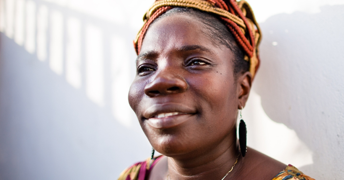 Liberian journalist Mae Azango stands outside the offices of Front Page Africa in Monrovia, Liberia.</p>