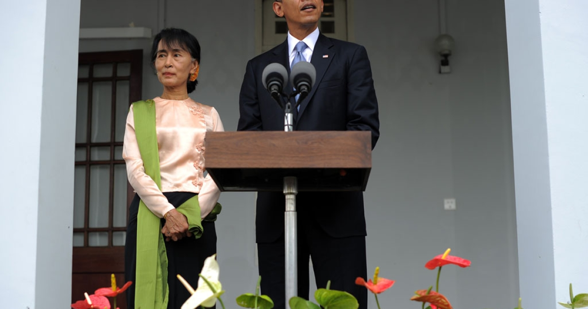 US President Barack Obama speaks as Myanmar opposition leader Aung San Suu Kyi listens in Yangon on November 19, 2012. Huge crowds greeted Barack Obama in Myanmar on the first visit by a serving US president to the former pariah state to encourage a string of startling political reforms.</p>