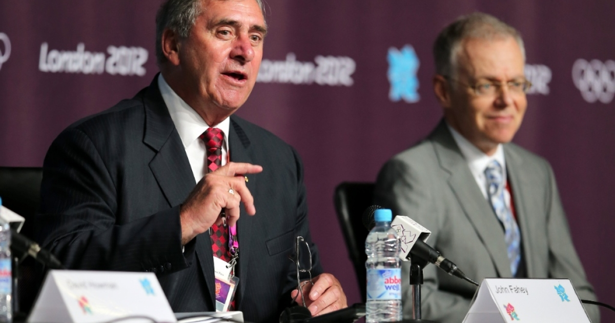 President of the World Anti-Doping Agency John Fahey (L) speaks as President of FINA Rene Bouchard (R) watches on during a World Anti Doping Agency Briefing ahead of the 2012 London Olympic Games at the Main Press Centre on July 25, 2012 in London, England.</p>