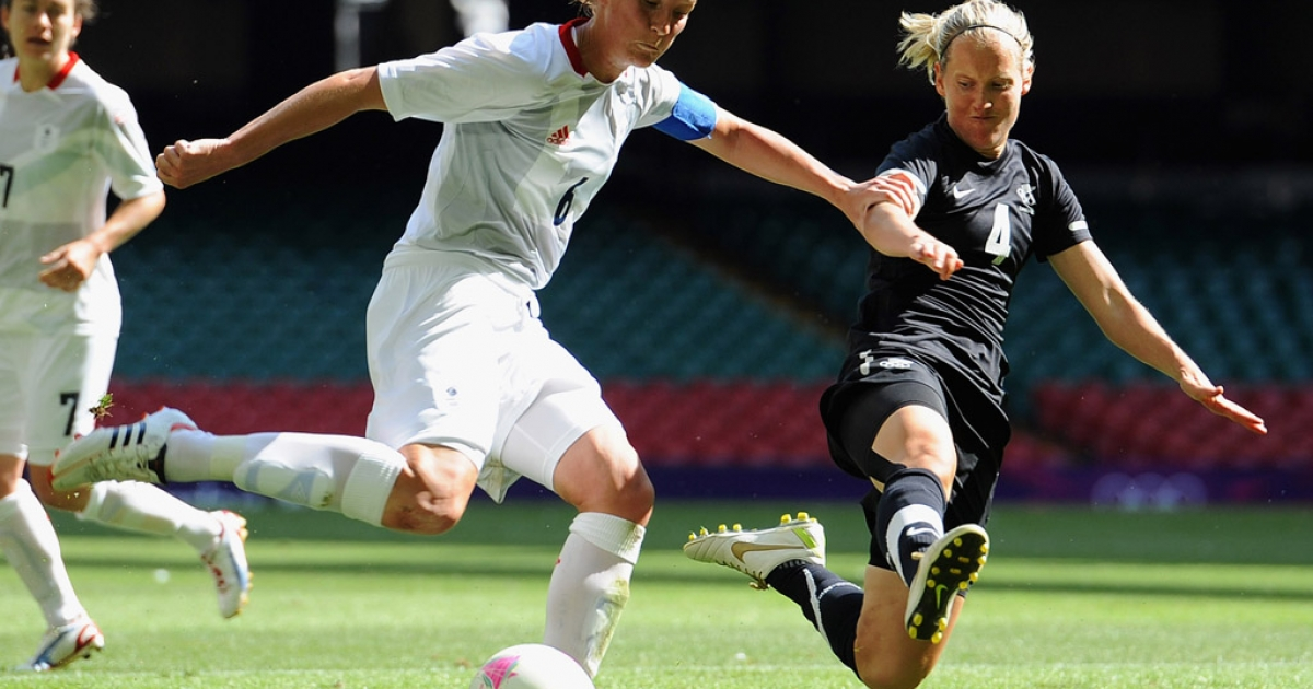 Casey Stoney of Great Britain and Katie Hoyle of New Zealand battle during a women's soccer match at the 2012 London Olympics at Millennium Stadium on July 25, 2012 in Cardiff, Wales.</p>