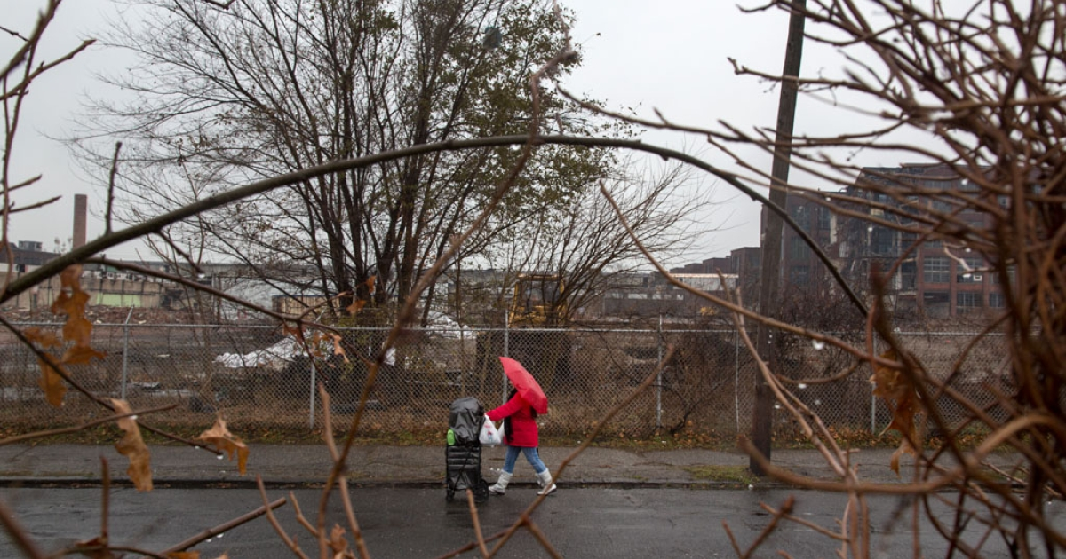 Scenes of the partially torn down Remington Arms factory with cemetery workers cleaning up the St. Augustine Cemetery in East Bridgeport, CT on November 27, 2012.</p>