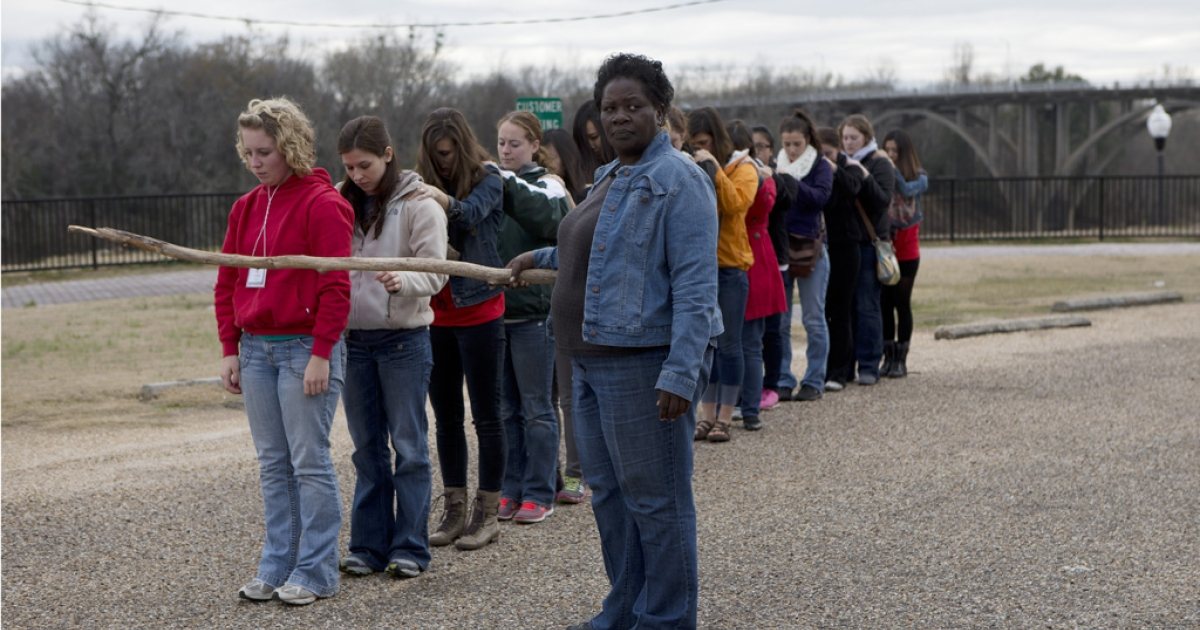 University of Wisconsin students taking a slavery reenactment lesson at the Slavery Museum in Selma, Alabama.</p>