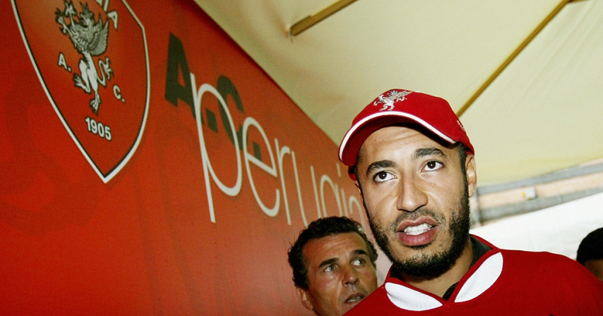 Saadi Kadhafi, son of Libyan leader Moamar Kadhafi, wears his new Perugia soccer team jersey after he his official player presentation in Torre Alfina 29 June 2003.</p>