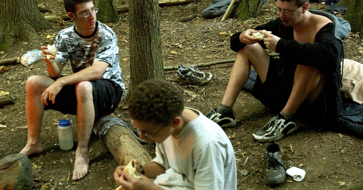 Students eat while camping out at the Center for Attention and Related Disorders camp — which provides the structure, discipline, and social order necessary for children who suffer from Attention Deficit Hyperactivity and similar disorders — at the Great Hollow Wilderness School July 30, 2003 in New Fairfield, Connecticut.</p>