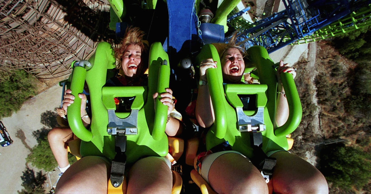 VALENCIA - August 24: Lois Eldridge (L) and her twin sister Linda White brave Deja Vu during the media preview of the new rollercoaster ride August 24, 2001 at Six Flags Magic Mountain in Valencia, CA.</p>