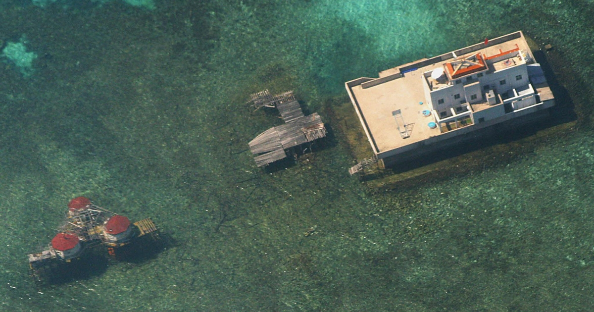 An aerial photograph taken from a Philippine Air Force aircraft shows Chinese built structures on the Mischief Reef in the disputed Spratly islands, located in the South China Sea.</p>
