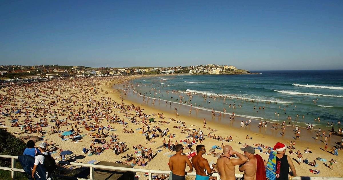 People crowd onto Bondi Beach in Sydney, Australia, to celebrate an Australian Christmas.</p>