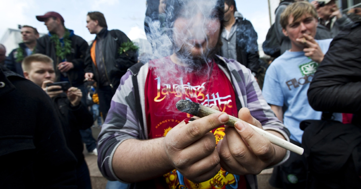 Protesters smoke marijuana during a demonstration against new government legislation calling for the creation of a