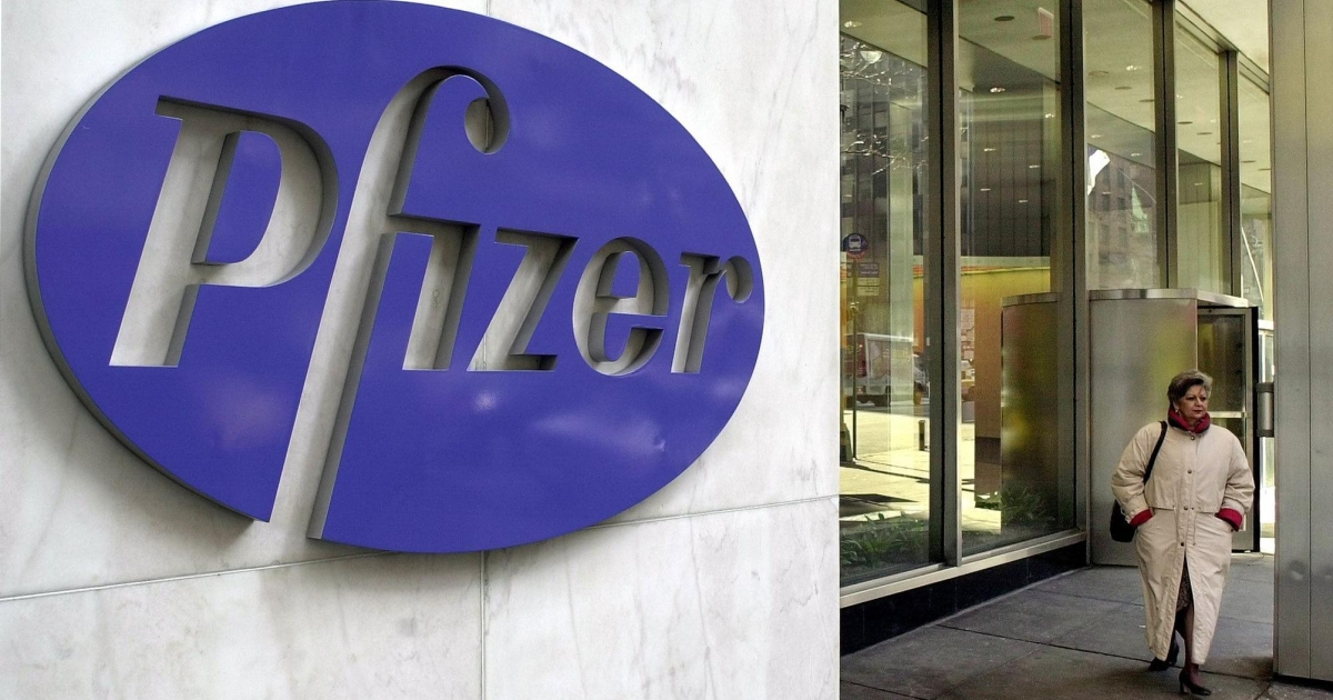 A woman leaves Pfizer's New York headquarters.</p>