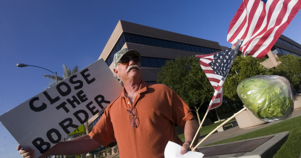 Ross Withers of Camp Verde, Arizona, a member of the The Minuteman Civil Defense Corps demonstrating in front of Senator John McCain's state offices on April 14, 2006 in Phoenix, Arizona.</p>