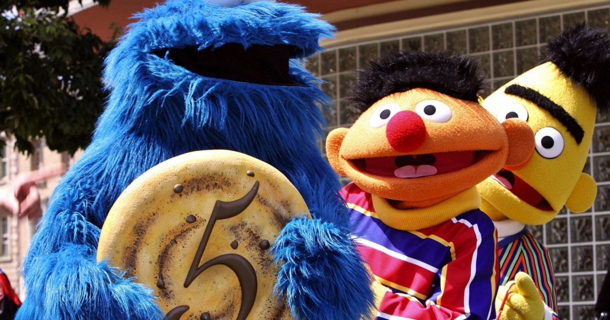 Sesame Street characters Cookie Monster, Ernie (center) and Bert (behind) at the fifth anniversary of Hollywood theme park Universal Studios Japan in Osaka.</p>
