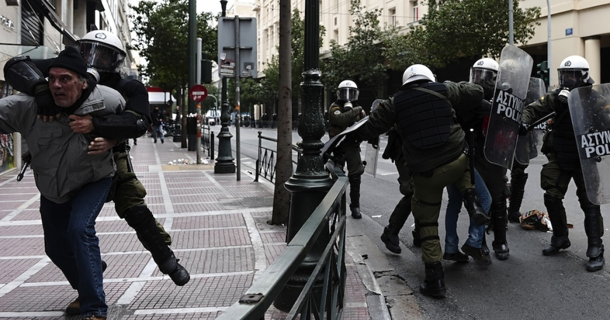 Protesters clash with riot police in Athens on Feb. 10.</p>