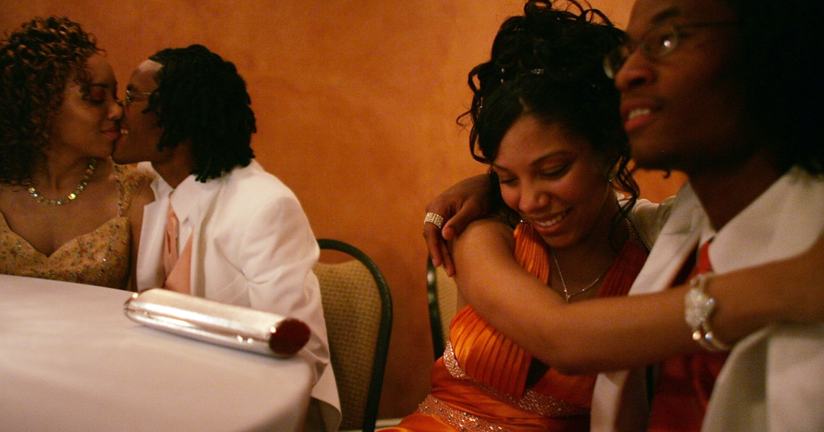 Students (R to L) Michael Phillips, Hazzarra Dykes, Maurice Phillips and Brittany Foy from John McDonogh High School embrace at their prom June 1, 2007 in New Orleans, Louisiana.</p>