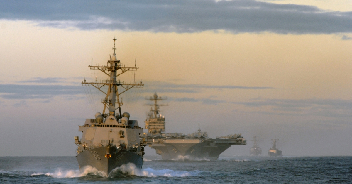 A handout image provided by the US Navy shows ships assigned to USS Abraham Lincoln Strike Group trailing behind the guided missile destroyer USS Momsen during a straight transit exercise January 26, 2008 off the coast of Southern California.</p>