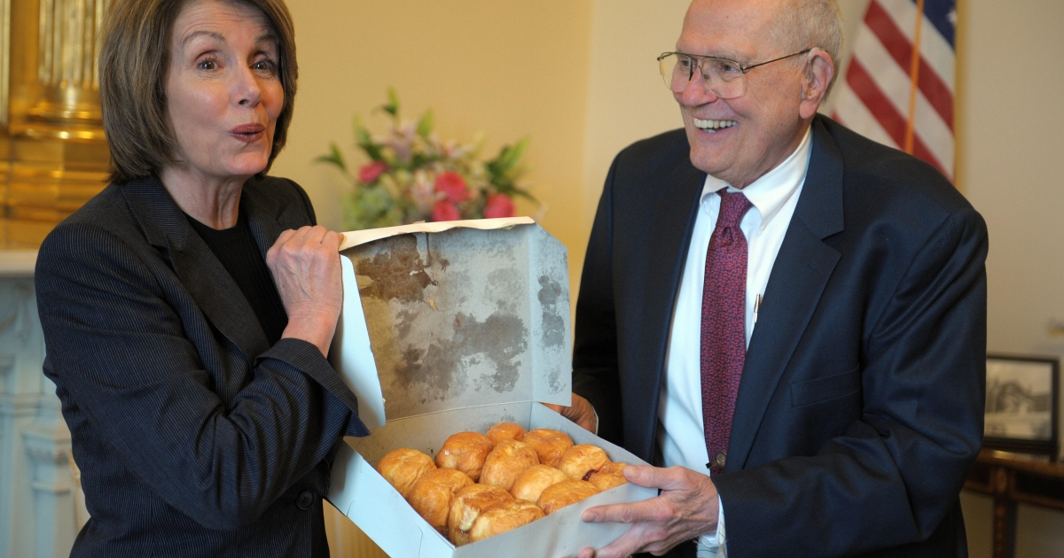 Former US Speaker of the House Nancy Pelosi is given a box of paczki, a traditional pastry commonly eaten on Fat Tuesday, from the Chene Modern Bakery in Detroit.</p>