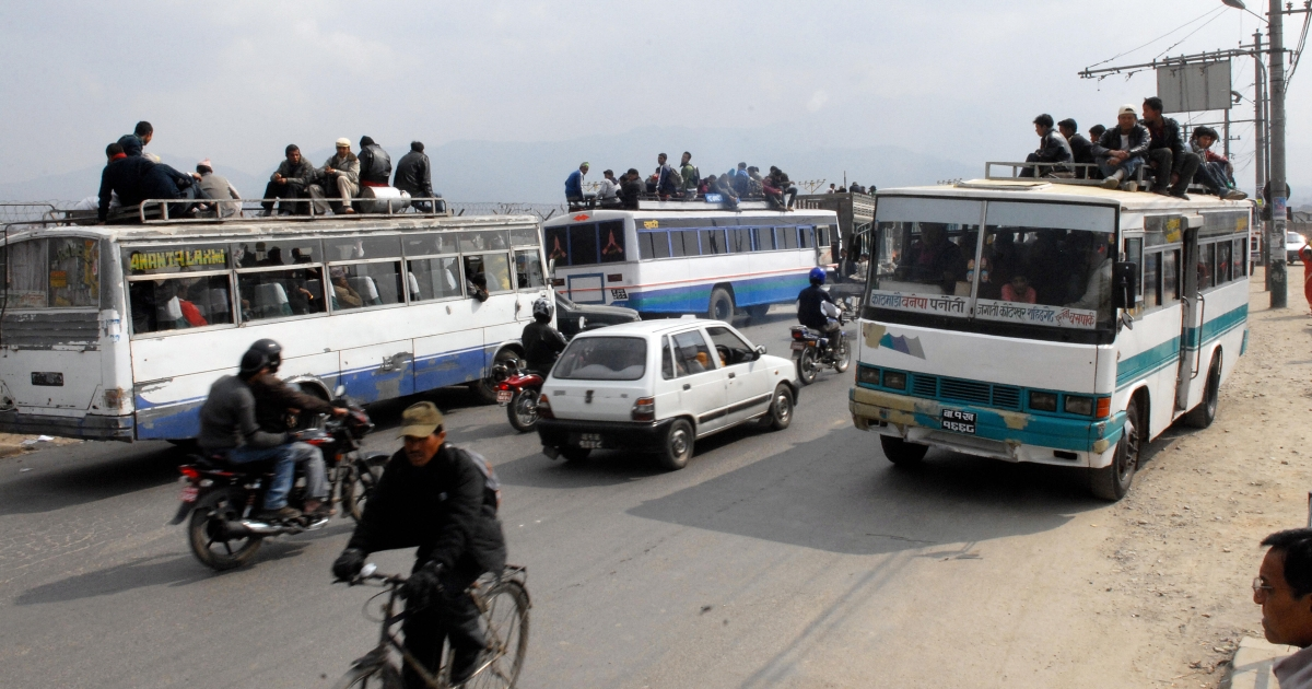 Nepalese commuters travel atop of the buses along Arniko Highway in Kathmandu, February 20, 2008.</p>