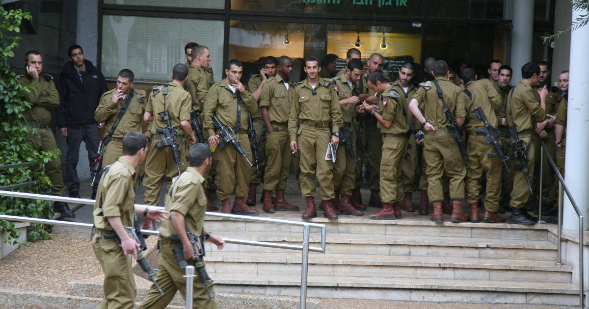 Israeli Defense Force (IDF) soldiers on Rothschild Boulevard in Tel Aviv.</p>