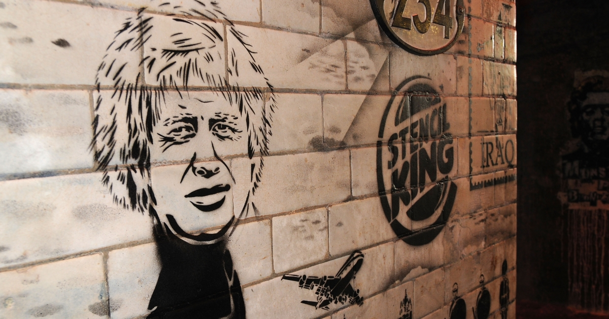 A stencil art piece depicting new London Mayor Boris Johnson is pictured as a giant new exhibition space created by famed graffiti artist Banksy opens to the public on May 3, 2008.</p>