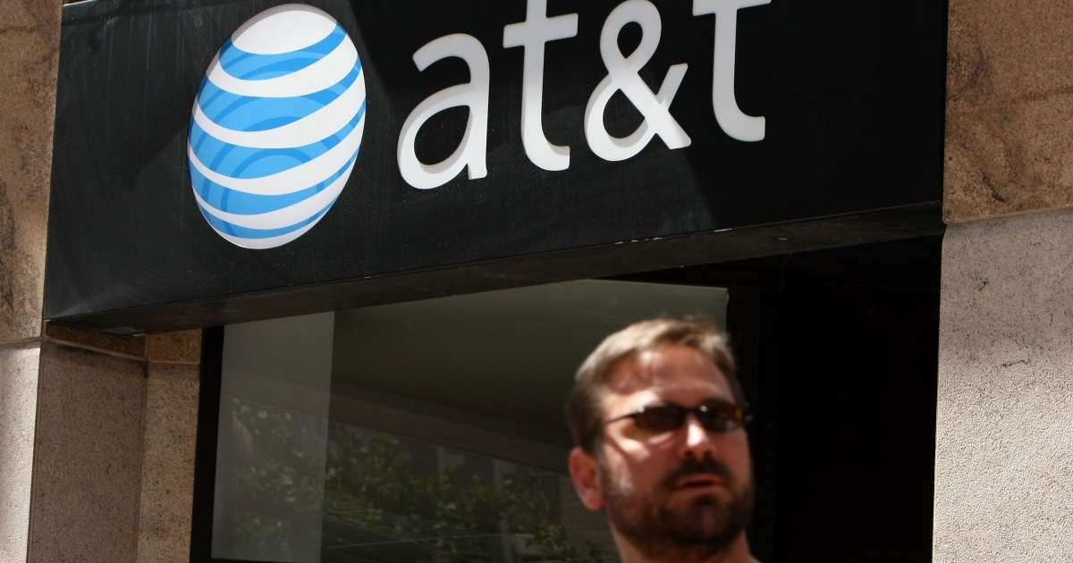 A pedestrian walks by an AT&amp;T Wireless store July 23, 2008 in San Francisco, California.</p>