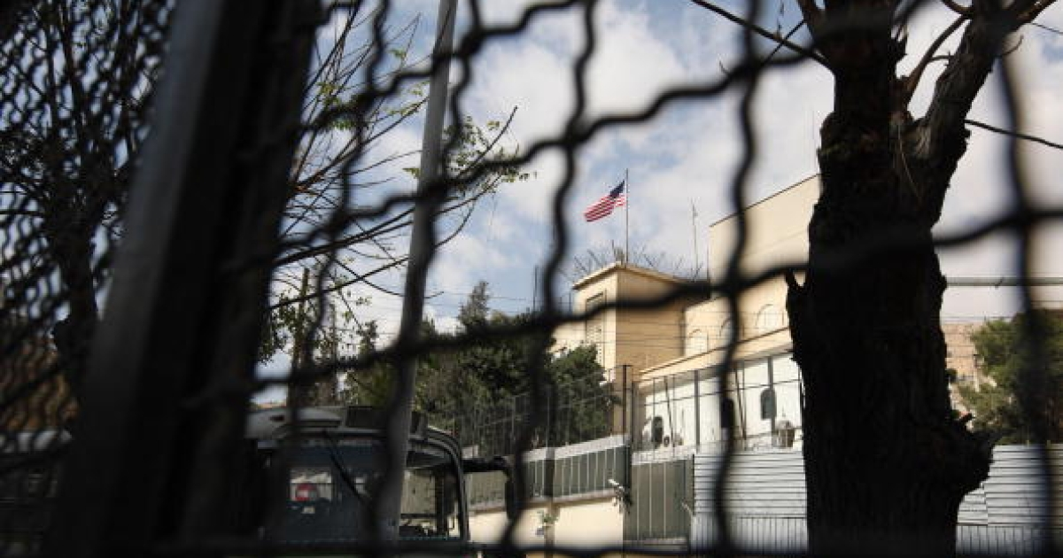 The U.S. flag flutters over the U.S. Embassy in Damascus in October 2008.</p>