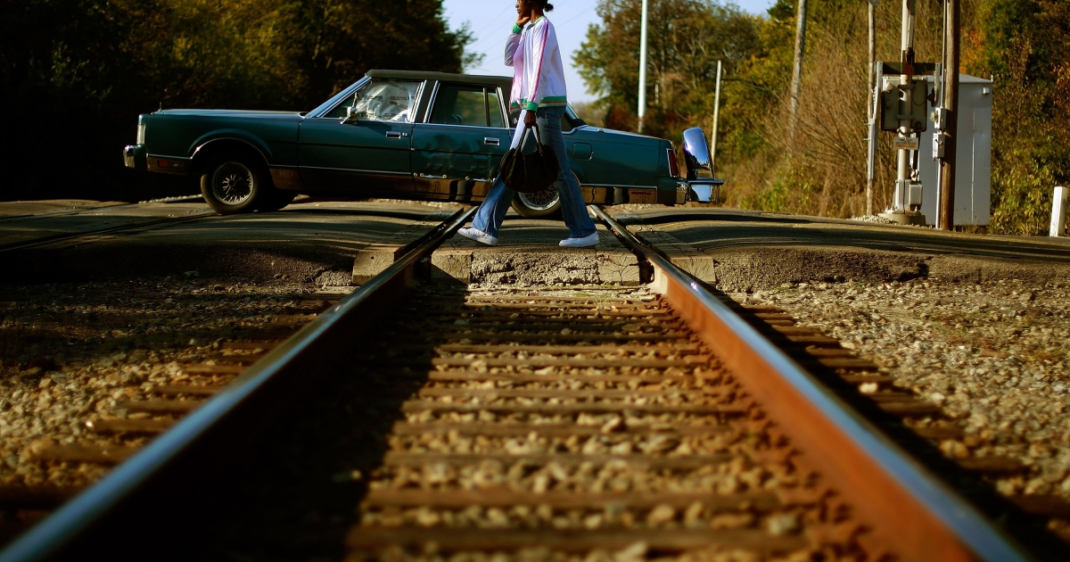 A woman crosses to the other side of the tracks November 4, 2008 in Birmingham, Alabama.</p>