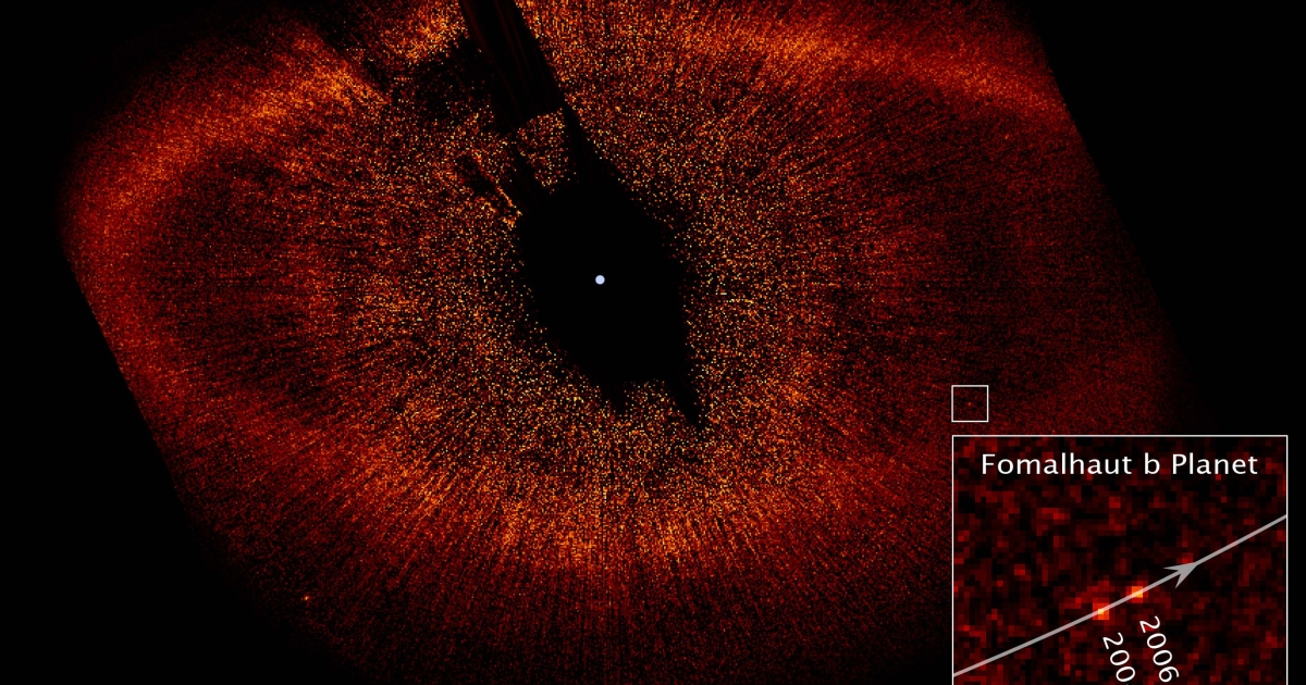 A visible-light image from the Hubble Space Telescope showing a red ring of dust and debris that surrounds the star Fomalhaut and the newly discovered planet, Fomalhaut b, orbiting its parent star.</p>