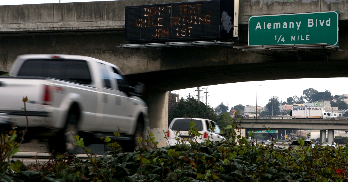 Cars drive on Interstate 280 by a notification of a new texting while driving law December 29, 2008 in San Francisco, California.</p>