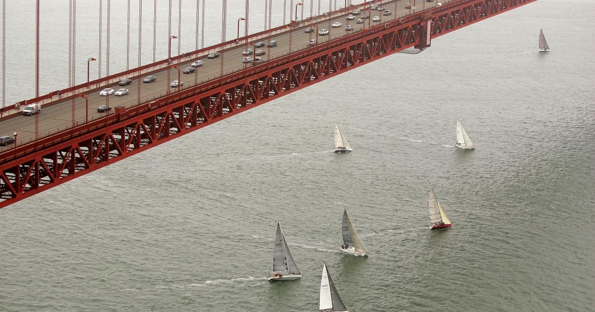Boats sail past the Golden Gate Bridge in San Francisco, California.</p>