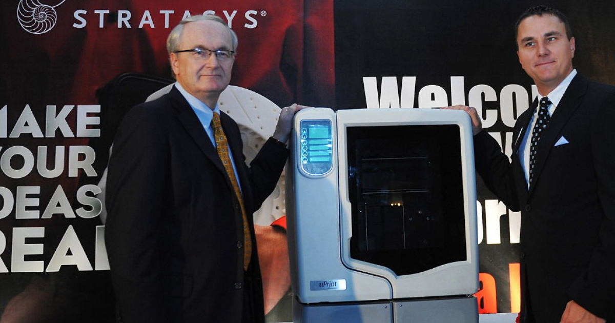 Product Marketing Manager of Stratasys Inc, Fred Fischer (R) and Vice President International Sales, Woody Frost stand next to the newly launched U-print 3D printer in Bangalore on July 30, 2009. Design Tech Systems, the sole country-wide distributor of Stratasys, organised the conference to launch U-Print, a personal 3D printer from their dimension series in India.</p>