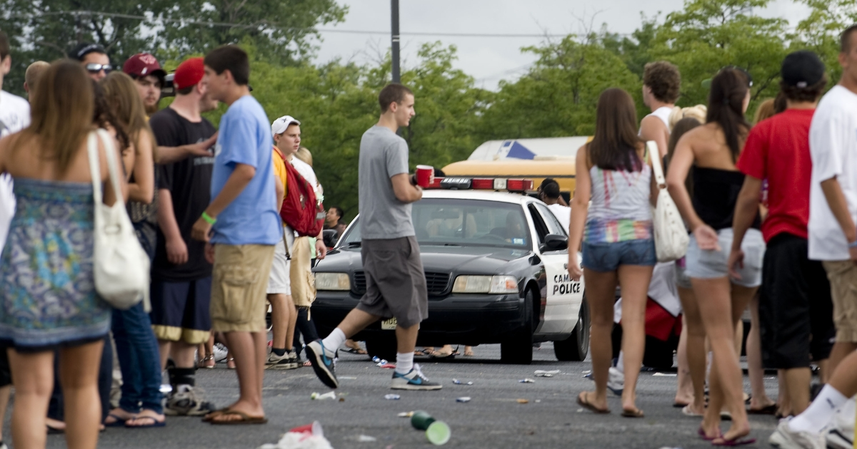 Camden Police patrol concert-goers tailgating prior to the America's Most Wanted Music Festival in Camden, New Jersey.</p>
