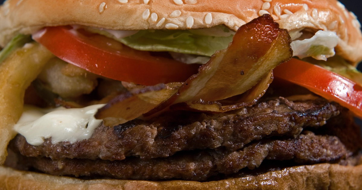 Burger King's Angry Triple Whopper includes three beef patties and bacon.</p>