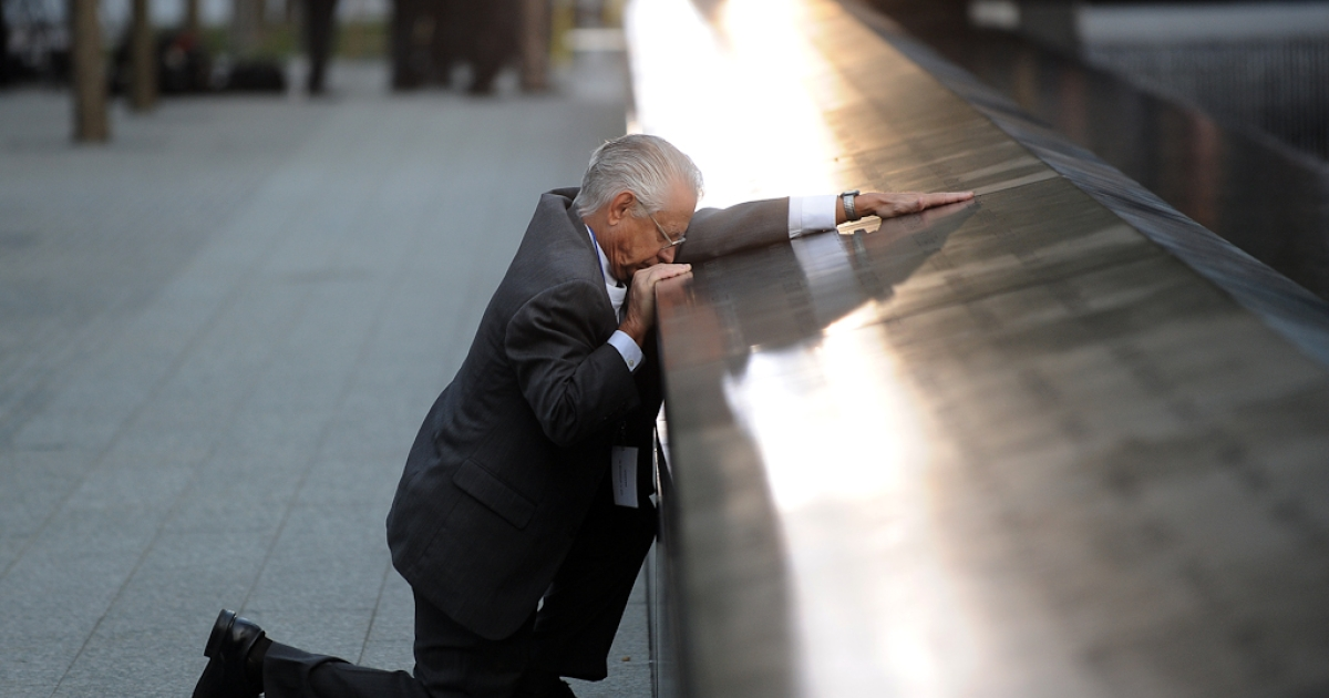 Robert Peraza, who lost his son Robert David Peraza, pauses at his son's name at the North Pool of the 9/11 Memorial during the 10th anniversary ceremonies at the site of the World Trade Center on Sept. 11, 2011.</p>