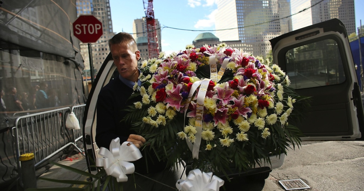 Fire fighter John Manning delivers a wreath to Engine Company 10 across from Ground Zero in New York City on the eve of the 11th anniversary of the September 11 terrorist attacks. Engine Company 10 lost six members that day.</p>